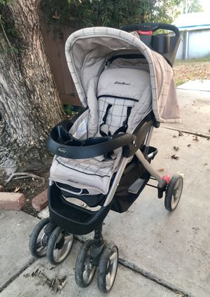 Stroller - Eddie Bauer, cup holder, Phone compartment/ storage space, easy collapsible, top viewer, bottom storage, back storage, folds up with one b for Sale in Galt, CA