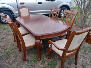 Magnificent hand-carved wood dining room table + 2 Leaf extensions with six chairs 2 with armrest can deliver! for Sale in Pompano Beach, FL