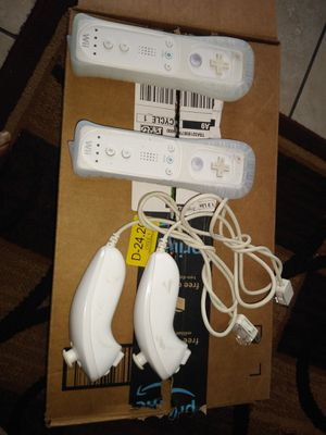 2 Nintendo Wii remotes and nunchuks for Sale in Lakewood, CA
