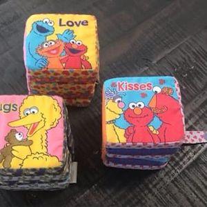 3 Sesame Street Soft Play Block Books Love Hugs Kisses $5 for all for Sale in Port St. Lucie, FL