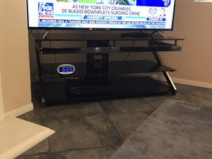 Television stand. 3 glass levels, very sturdy, like brand new. for Sale in Temecula, CA