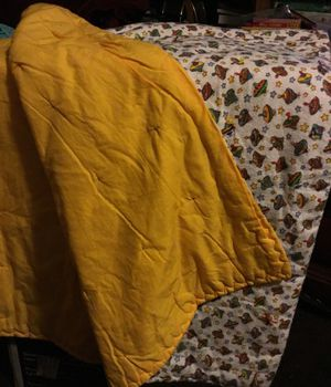 One. Reverse baby quilt with yellow with print color on the other side for Sale in North Las Vegas, NV
