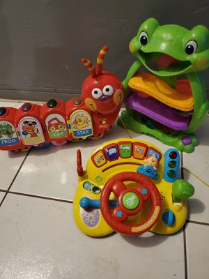 VTECH LEARN DRIVE, FISHER PRICE CATERPILLAR WALKER AND A SLIDE BALLS FROG for Sale in Miami, FL