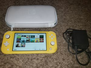 Nintendo switch lite with 7 games plus carrying case for Sale in Carrollton, TX