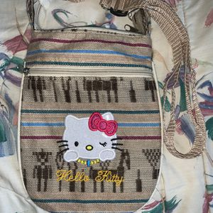Light Brown Hello Kitty Purse 2 Zipper 48-Inch Adjustable Strap Crossbody for Sale in Centreville, VA
