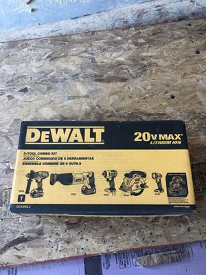 Dewalt 20 volt 5 tool combo kit light saw impact driver saw all hammer drill new still in box sells for 599.00 for Sale in Martinsburg, WV