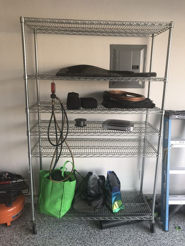 "Storage organizer, has wheels on all 4 legs. Nothing on the shelves are for sale. Measures 48"" x 77"""