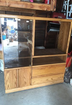 Oak entertainment center. Good shape. Needs to be cleaned up. Light I. Glass cabinet but two large drawers and storage on bottom for Sale in Garfield Heights, OH