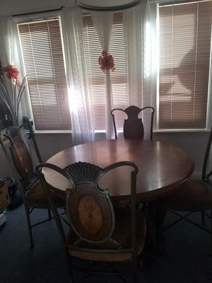Solid Wood and metal table with 4 chairs. for Sale in Denver, CO