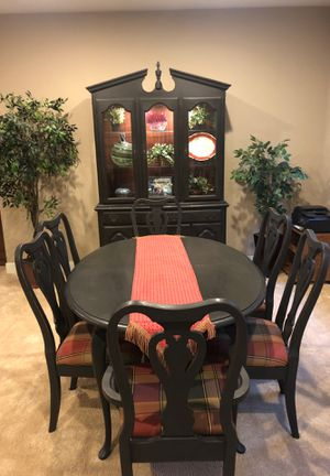 Dining room table, 6 chairs and beautiful lighted hutch and a leaf for the table which easily seats 8 people for Sale in Denver, CO