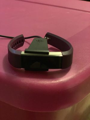 FitBit Alta with USB charger and SM purple band for Sale in Durham, NC