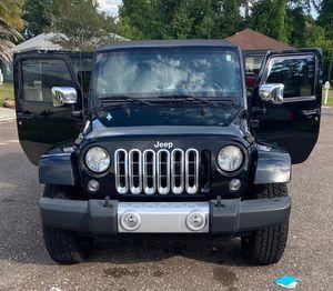 2014 Jeep Wrangler Sahara unlimited for Sale in Jacksonville, FL