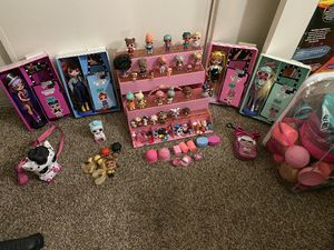 Lol dolls small, big dolls and piggy bank lol surprise and cat for Sale in San Diego, CA