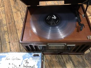 Antique record player with records for Sale in Evanston, IL