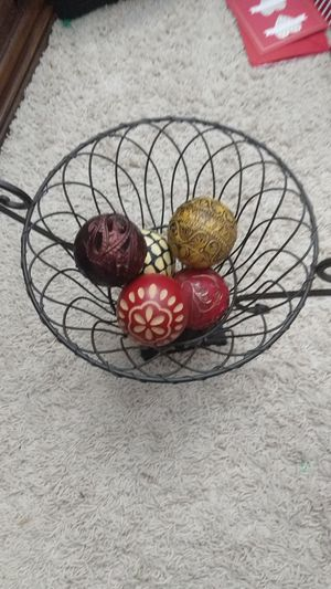 Wire basket with wooden balls for Sale in Rochester, NY