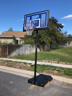 Adjustable basketball hoop up to 12ft for Sale in Sandy, UT