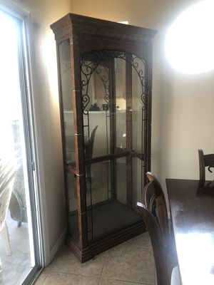 Curio with glass shelving (4) and light. for Sale in Las Vegas, NV
