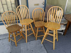 Four wood country swivel revolving stool bar chair for Sale in Long Beach, CA
