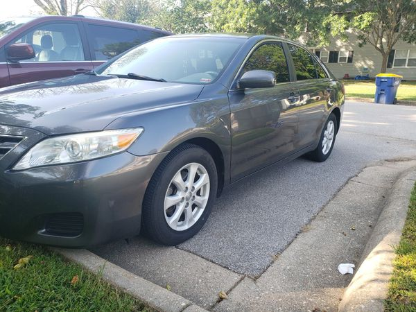 Toyota Camry 2010 with tan window back up camera and tough screen radio