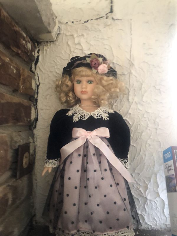 Porcelain Doll in pink dress standing