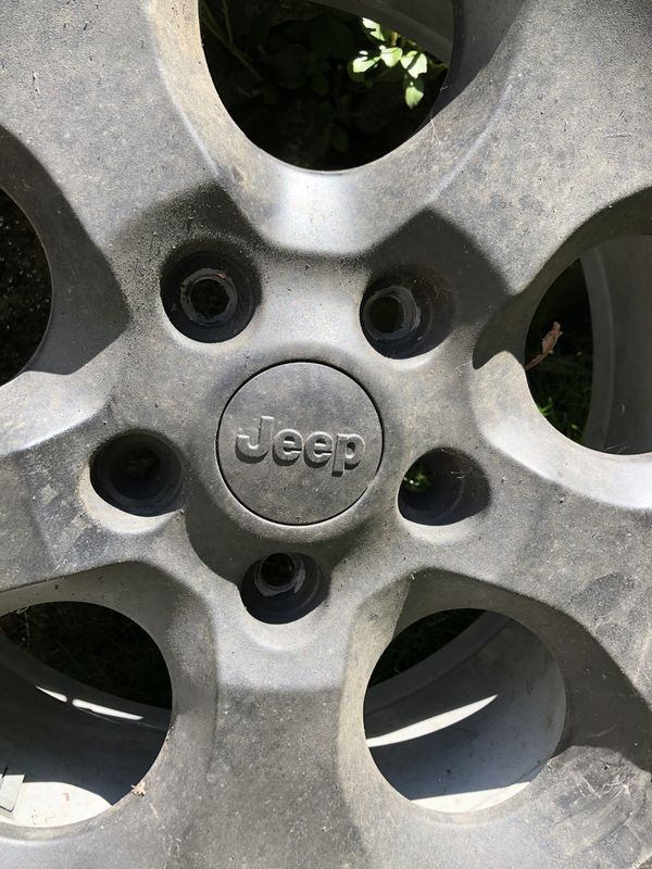 Original Jeep tires and wheels. All in wonderful condition. A set of 5 P255/70R18. Asking $800