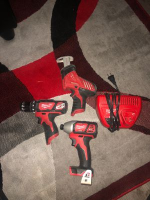 1) m18 impact drill, 1) m12 drill, 1)m12 hacksaw, and an m12 charger.. impact drill only used 2 times for Sale in Houston, TX