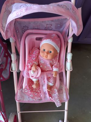 Small stroller with baby with car seat pacifier receiving blanket $15 Palmdale California for Sale in Palmdale, CA