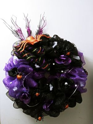 HALLOWEEN wreath with purple lights,orange spiders, purple and black flowers, gems and eye balls. for Sale in Richland, WA