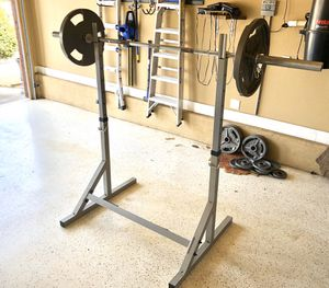 Olympic Barbell, Weights (255lbs) and Squat Stand for Sale in Bentonville, AR
