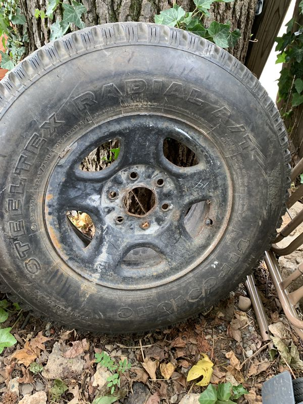 Firestone tire plus rim. 245 75 16