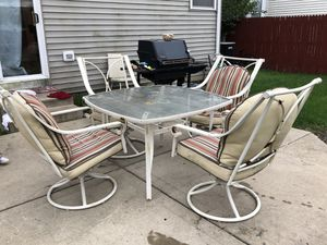 Patio Set Table & (4) Chairs Metal Glass Swivel Rock WITH Cushions Outdoor Garden Furniture for Sale in Plainfield, IL
