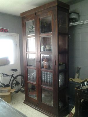 8ft 4 inch tall solid wood curio/display cabinet. I paid $1600 for it on sale for Sale in Greenville, MS