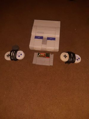 Super Nintendo Donkey Kong Country Plus two controllers for Sale in Phoenix, AZ