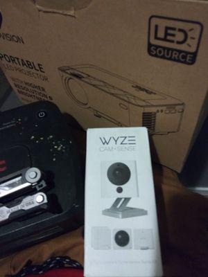 Wyze camera and a mini portable projector for Sale in Dallas, TX