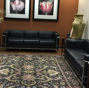 2 loveseat black leather sofas with stainless frame for Sale in New Port Richey, FL