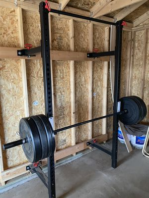 Wall-mounted Squat rack, Olympic barbell, 230 pounds of bumper plates for Sale in Denver, CO
