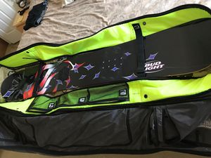 Palmer snowboard and Ogio rolling bag for Sale in Largo, FL