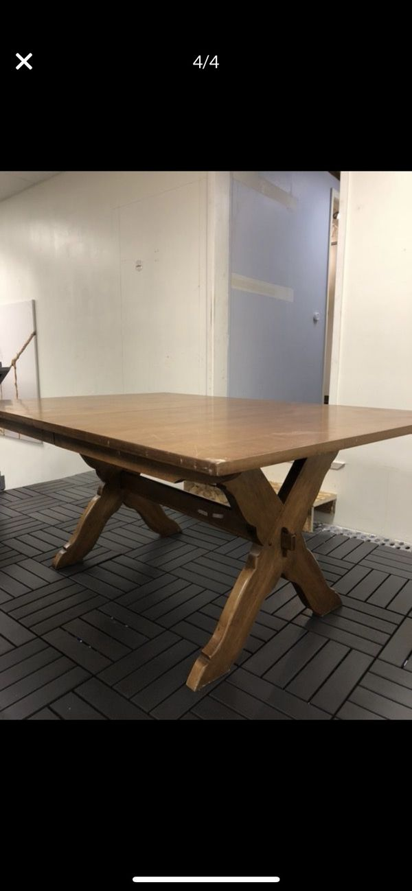 Solid wood dining table with sleeves