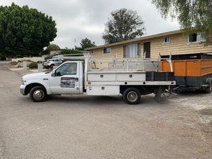 350 ford work truck flatbed with rack, toolboxes 250,000 works good for Sale in Spring Valley, CA