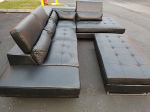 Black Leather sectional and ottoman for Sale in Oxon Hill, MD