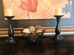 Home decor candle stands are 10 inches long with the candle they stand at 13 inches long the bowl is metal. Comes with the balls for Sale in Humble, TX