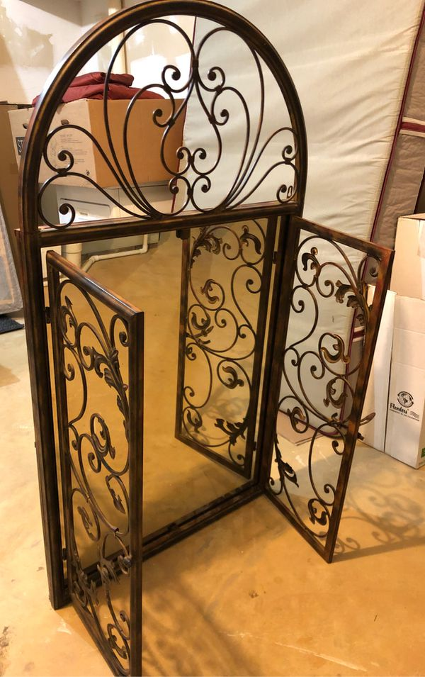Decorative mirror with metal frame and swinging doors