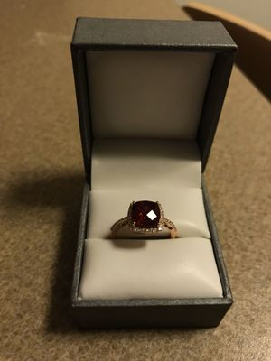 2 carat ruby 14 karat rose gold size 7 ring surrounded by diamonds for Sale in Phoenix, AZ