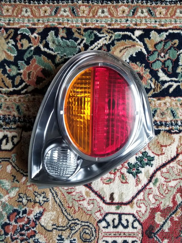 2003 Nissan Maxima GLE Driver side tail lamp
