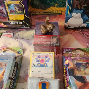 Pokemon Card Bundle. Vivid Voltage Theme Decks, Rebel Clash Etb, Bloster Pack, Top Loaders, Sleeves, And Morpeko/Snorlax Pin Collections for Sale in St. Petersburg, FL