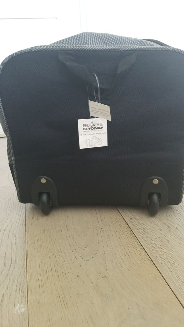"Brand new 32"" expandable rolling duffle bag"