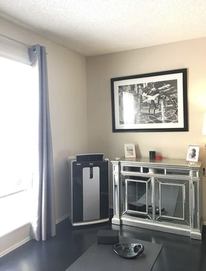 Air Conditioner, Heater, Dehumidifier -freestanding window unit with remote for Sale in Newport Beach, CA