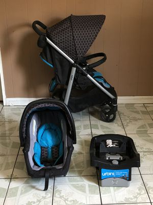 LIKE NEW URBINI TRAVEL SYSTEM STROLLER CAR SEAT AND BASE for Sale in Riverside, CA