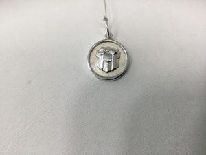 Tiffany and Co Present pendant/ charm for Sale in Tampa, FL