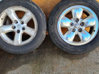 2 Dodge Ram Rims And Tires. Will Separate Anyway You Need Message For More Details for Sale in Springfield,  IL